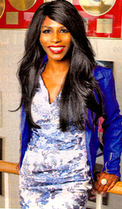 Sinitta in the Bluebelle Dress - Featured in OK Magazine